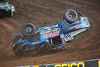 Dec. 11, 2011; Chandler, AZ, USA;  LOORRS pro 2 driver Robby Woods (99) crashes during the Lucas Oil Challenge Cup at Firebird International Raceway. Mandatory Credit: Mark J. Rebilas-