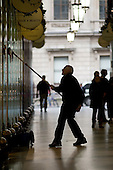 A man cleans the windows of exclusive shops in the Picadilly Arcade, Mayfair, London.