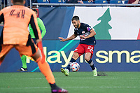 FOXBOROUGH, MA - JULY 25: Carles Gil #22 of New England Revolution crosses the ball near the CF Montreal goal during a game between CF Montreal and New England Revolution at Gillette Stadium on July 25, 2021 in Foxborough, Massachusetts.