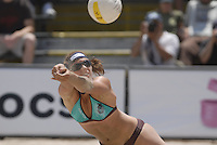 Huntington Beach, CA - 5/5/07:   Misty May-Treanor dives for the ball during May-Treanor / Walsh's 21-14, 21-12 victory over McPeak / Tom Saturday during the 2007 AVP CROCS Tour in Huntington Beach..Photo by Carlos Delgado