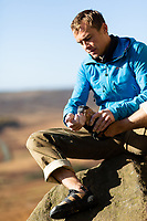 Leo Houlding seen cleaning his climbing shoes, Peak District, United Kingdom