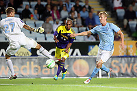 Thursday 08 August 2013<br /> Pictured: Jonathan de Guzman of Swansea (C) charges past Malmo goalkeeper Johan Dahlin (L) and another defender but fails to score<br /> Re: Malmo FF v Swansea City FC, UEFA Europa League 3rd Qualifying Round, Second Leg, at the Swedbank Stadium, Malmo, Sweden.