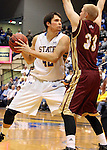 BROOKINGS, SD - FEBRUARY 27:  Jordan Dykstra #42 from South Dakota State holds the ball while Nate Engesser #33 from Denver University applies pressure in the first half of their game Thursday night at Frost Arena in Brookings. (Photo by Dave Eggen/Inertia)