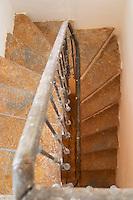A winding staircase. Chateau de Lascaux, Vacquieres village. Pic St Loup. Languedoc. France. Europe.