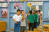 MR/Schenectady, New York.Yates Arts Magnet School - Pre-Kindergarten.Boys (4) sing into pretend microphones and move to music at free playtime..MR: Fen1, Mcg1, Gar4.PN#:29057      FC#:23073-00120.scan from slide.© Ellen B. Senisi