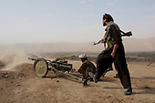 Khogebha Hoddin, Northern Afghanistan <br /> October 2001<br /> <br /> The Northern Alliance fires an old canon at the front lines with the Taliban near Khogebha Hoddin.