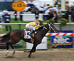 Calvin Borel sends a kiss to the crowd as he crosses the finish line first in the 2009 Preakness Stakes.