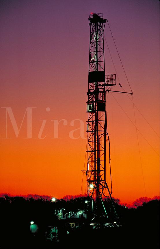 Petroleum Industry; oil; drilling rig; production; domestic; dusk; twilight. Houston Texas.