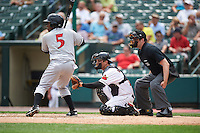 Rochester Red Wings catcher John Ryan Murphy (12) and umpire John Bacon await a pitch as Gift Ngoepe (5) bats during a game against the Indianapolis Indians on May 26, 2016 at Frontier Field in Rochester, New York.  Indianapolis defeated Rochester 5-2.  (Mike Janes/Four Seam Images)