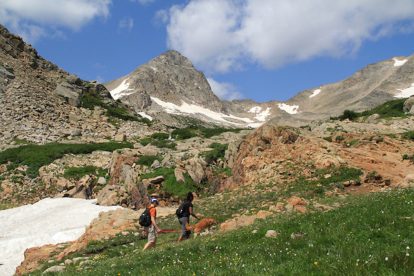Senior couple hike with dog along Maroon Lake, Maroon Bells, Colorado. Private photo tours to Indian Peaks. Private photo tours to Indian Peaks.