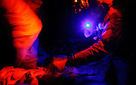 """2 US soldiers, wounded in an Improvised Explosive Deviece (IED) attack, are treated by medics on a Medevac helicopter from the 101st Aviation Regiment as it flies a rescue mission at night to take them to Forward Operating Base Orgun-E in Paktika province, Afghanistan, 21 July, 2008. Also known by their call sign """"Dust Off"""","""" the Medevac pilots, crew and medics are ready to fly at a moments notice, picking up Coalition soldiers as well as Afghans that require help.(John D McHugh)"""