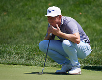5th June 2021; Dublin, Ohio, USA;  Bo Hoag (USA) studies his line before putting on the 2nd green during the third round of the Memorial Tournament at Muirfield Village Golf Club in Dublin, Ohio on June 05, 2021.