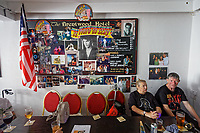 Pictured: Two diners enjoy a drink in Brentwood Hotel which is renamed to Heartbreak Hotel for the festival. Sunday 29 September 2019<br /> Re: Porthcawl Elvis Festival in south Wales, UK.