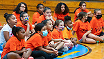 WATERBURY, CT 072721JS12 Area girls listen to introductions from Margaret Heyward during  the Girls Mentoring Girls basketball clinic at the North End Rec Center in Waterbury. The clinic is open to girls ages 8-13. <br /> Jim Shannon Republican American