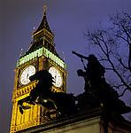 United Kingdom, England, London: Nightshot of Big Ben with statue of Boudicca
