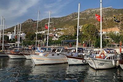Turkey, Province Antalya, Kalkan: popular resort, Gulets in harbour   Tuerkei, Provinz Antalya, Kalkan: beliebter Ferienort an der Mittelmeerkueste, Ausflugsschiffe (Gulets) im Hafen