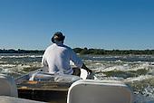 Mato Grosso State, Brazil. Xingu River; Von Martius falls. Boatman Paulo Juruna.