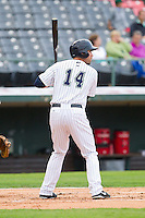 Travis Ishikawa (14) of the Charlotte Knights at bat against the Lehigh Valley IronPigs at Knights Stadium on August 6, 2013 in Fort Mill, South Carolina.  The IronPigs defeated the Knights 4-1.  (Brian Westerholt/Four Seam Images)