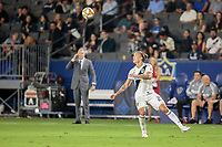 CARSON, CA - SEPTEMBER 15: Rolf Feltscher #25 of the Los Angeles Galaxy heads a ball during a game between Sporting Kansas City and Los Angeles Galaxy at Dignity Health Sports Complex on September 15, 2019 in Carson, California.