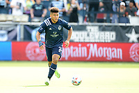 KANSAS CITY, KS - JUNE 26: Jaylin Lindsey #2 Sporting KC with the ball during a game between Los Angeles FC and Sporting Kansas City at Children's Mercy Park on June 26, 2021 in Kansas City, Kansas.