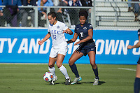 Cary, North Carolina - Sunday December 6, 2015: Kayla McCoy (12) of the Duke Blue Devils keeps the ball away from Elizabeth Ball (7) of the Penn State Nittany Lions during second half action at the 2015 NCAA Women's College Cup at WakeMed Soccer Park.  The Nittany Lions defeated the Blue Devils 1-0.