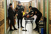 Pictured: Physiotherapy takes place in a corridor. Thursday 18 January 2018<br /> Re: Players and staff of Newport County Football Club prepare at Newport Stadium, for their FA Cup game against Tottenham Hotspur in Wales, UK
