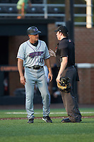 Winston-Salem Dash manager Omar Vizquel (13) has a discussion with home plate umpire Austin Jones during the game against the Buies Creek Astros at Jim Perry Stadium on August 15, 2018 in Buies Creek, North Carolina.  The Astros defeated the Dash 5-0.  (Brian Westerholt/Four Seam Images)