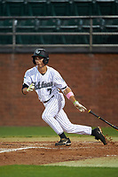 Stetson Hatters shortstop Matt Morales (7) at bat during a game against the Siena Saints on February 23, 2016 at Melching Field at Conrad Park in DeLand, Florida.  Stetson defeated Siena 5-3.  (Mike Janes/Four Seam Images)