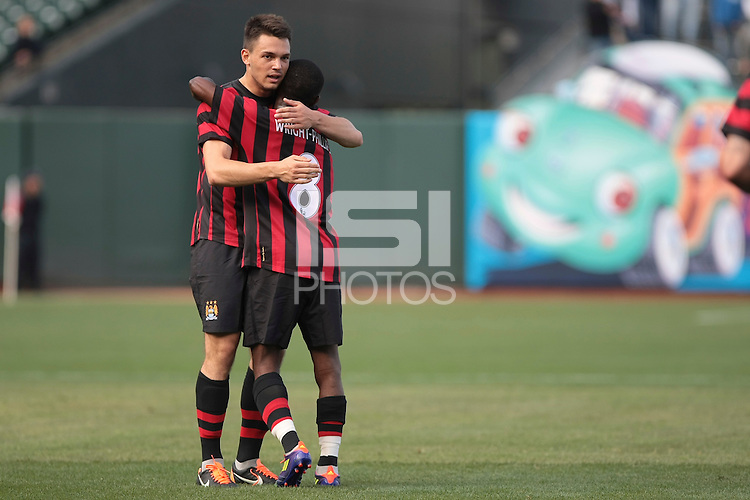 Frederic Veseli (left) hugs Shaun Wright-Phillips after (right) the goal. Manchester City defeated Club America 2-0 in the Herbalife World Football Challenge 2011 at AT&T Park in San Francisco, California on July 16th, 2011.