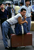 A jobseeker from northern China waits at Guangzhou's railway station.