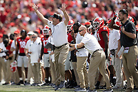 ATHENS, GA - OCTOBER 2: Kirby Smart shouts instructions to his team during a game between Arkansas Razorbacks and Georgia Bulldogs at Sanford Stadium on October 2, 2021 in Athens, Georgia.