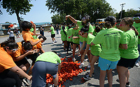 Students from Springdale and Har-Ber high schools throw tomatoes Thursday, Sept. 9, 2021, during the Tomatina, a tomato fight with historical roots in Spain, in Murphy Park in Springdale. Advanced placement Spanish language students from Springdale and Har-Ber high schools participated in the event. Visit nwaonline.com/210910Daily/ for today's photo gallery.<br /> (NWA Democrat-Gazette/Andy Shupe)