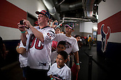 Houston, Texas<br /> October 2, 2011<br /> <br /> Fans, waiting outside the team's locker-room take pictures of the cheerleaders as they walk the hallways of the stadium. <br /> <br /> The Houston Texans defeated the Pittsburgh Steelers at the Reliant Stadium 17 to 10.