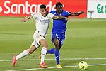 Getafe CF's Djene Dakonam (r) and Real Madrid's Mariano Diaz during La Liga match. April 18,2021. (ALTERPHOTOS/Acero)