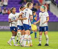 ORLANDO, FL - JANUARY 22: Lynn Williams #6 of the USWNT celebrates with Samantha Mewis #3 during a game between Colombia and USWNT at Exploria stadium on January 22, 2021 in Orlando, Florida.