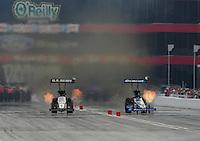 Jun. 19, 2011; Bristol, TN, USA: NHRA top fuel dragster driver Tony Schumacher (left) races alongside Brandon Bernstein during eliminations at the Thunder Valley Nationals at Bristol Dragway. Mandatory Credit: Mark J. Rebilas-