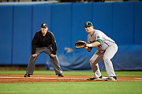 Siena Saints first baseman Joe Drpich (47) holds a runner on as umpire Chris Tipton looks on during a game against the Florida Gators on February 16, 2018 at Alfred A. McKethan Stadium in Gainesville, Florida.  Florida defeated Siena 7-1.  (Mike Janes/Four Seam Images)
