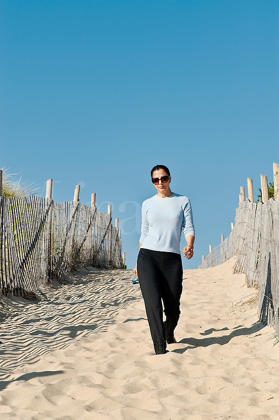 Woman relaxing at the beach, Cape Cod, MA, USA