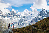 Arriving above Zinal, with views of the 4000 meter peaks above town, while trail running on the Via Valais, a multi-day trail running tour connecting Verbier with Zermatt, Switzerland.