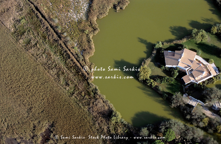 Private house nestled on a riverbank in Saintes-Maries-de-la-Mer, Camargue, France.