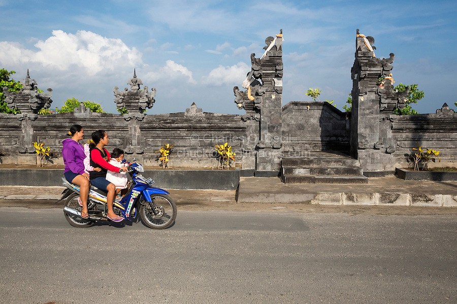 Bali, Indonesia.  Road Safety.  Two Women, Two Children on Motorbike, no Helmets.