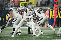 FOXBOROUGH, MA - NOVEMBER 24: Dallas Cowboys Quarterback Dak Prescott #4 peals out to hand off the ball during a game between Dallas Cowboys and New England Patriots at Gillettes on November 24, 2019 in Foxborough, Massachusetts.