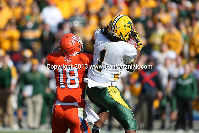 Sam Houston State Bearkats wide receiver Trey Diller (18) and North Dakota State Bison cornerback Marcus Williams (1) in action during the FCS Championship game between the North Dakota State Bison and the Sam Houston State Bearkats at the FC Dallas Stadium in Frisco, Texas. North Dakota defeats Sam Houston 39 to 13..
