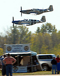 Staff Photo/Mike Ullery.A pair of Mustangs fly past the crowd at the Gathering of Mustangs and Legends.