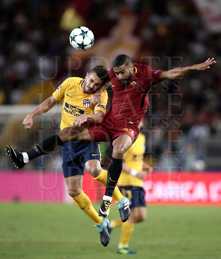 Football Soccer: UEFA Champions League AS Roma vs Atletico Madrid Stadio Olimpico Rome, Italy, September 12, 2017. <br /> Atletico Madrid's Koke (l) in action with Roma's Gregoire Defrel (r) during the Uefa Champions League football soccer match between AS Roma and Atletico Madrid at at Rome's Olympic stadium, September 12, 2017.<br /> UPDATE IMAGES PRESS/Isabella Bonotto