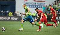 SEATTLE, WA - NOVEMBER 10: Seattle Sounders forward Jordan Morris #13 leads a breakaway during a game between Toronto FC and Seattle Sounders FC at CenturyLink Field on November 10, 2019 in Seattle, Washington.