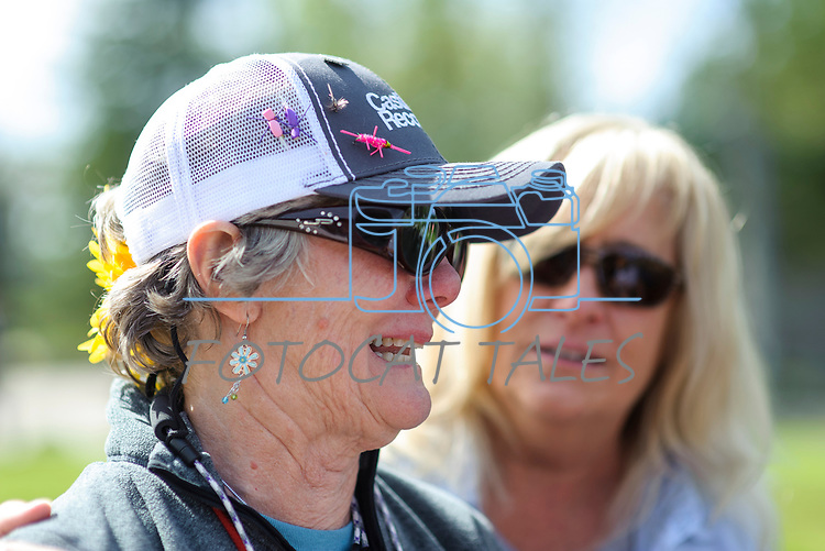 """Katie Lambie, a breast cancer survivor is comforted by her """"river buddy,"""" Kelleen Brehm, while becoming emotional after catching a rainbow trout during the Casting for Recovery fishing clinic at Bently Ranch in Gardnerville, Nev. May 4, 2018.<br /> Photo by Candice Vivien/Nevada Momentum"""