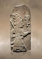 Hittite monumental relief sculpture ofa God probably holding lightning rods. Late Hittite Period - 900-700 BC. Adana Archaeology Museum, Turkey.