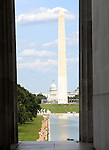 Washington Monument US Capitol from pillars Washington DC, pillars, Washington Monument,US Capital, United States Capital with flags, US flags, Lincoln memorial and washington monumnet, Washington DC, District, DC, capital, Potomac River, Washington Metropolitain, metropolitan area, federal district, federal government of USA, US Congress, White House, National Mall, Politics in the United States, Presidential, Federal Republic, united States Congress, powers, Judicial Power, House of Representatives, US Senate, Consitiution, federal law, Democratic Party, Republican party, two party system, Fine Art Photography by Ron Bennett, Fine Art, Fine Art photo, Art Photography,