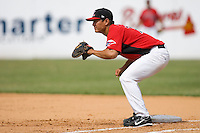 First baseman Jason Ogata #7 of the Hickory Crawdads on defense versus the West Virginia Power at L.P. Frans Stadium June 21, 2009 in Hickory, North Carolina. (Photo by Brian Westerholt / Four Seam Images)